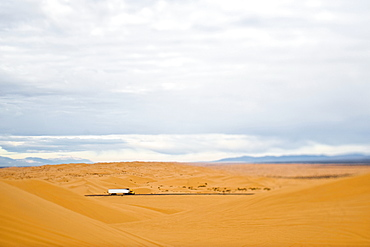 Truck Driving Through Desert, Imperial Sand Dunes, California, United States of America