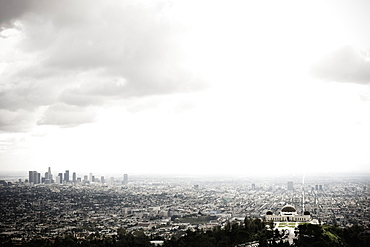 Los Angeles Skyline and Griffith Observatory Beneath Cloudy Sky, Los Angeles, California, United States of America
