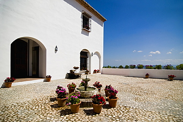 Flowerpots around fountain outside villa, Antequera, Andalucia, Spain