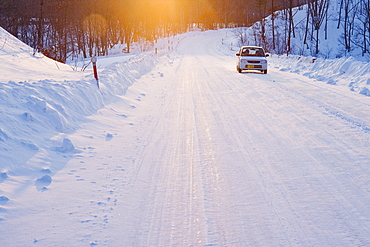 Car on Snow Covered Road, Hokkaido, Japan
