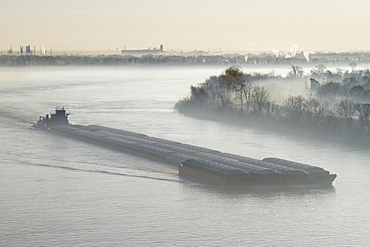 Mist Shrouded River and Tugboat, Louisiana, USA