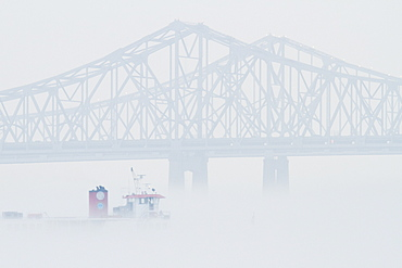 Bridge and Boat in Fog, New Orleans, Louisiana, USA
