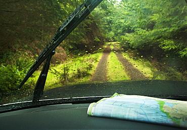 Windshield wipers and map on dashboard of car, Olympic Peninsula, Washington, USA