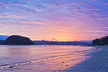 Boats sailing in bay at sunrise, Bay of Islands, Paihia, New Zealand, Bay of Islands, Paihia, New Zealand
