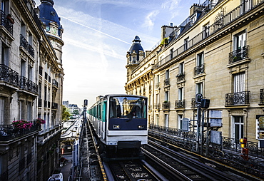 Streetcar passing between apartment buildings, Paris, France, Paris, France