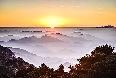 Fog rolling over rocky mountains, Huangshan, Anhui, China, Huangshan, Anhui, China