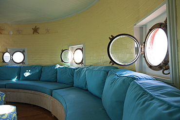 Port hole windows in round lighthouse living room, Newport News, Virginia, USA