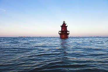 Lighthouse in ocean, Newport News, Virginia, USA