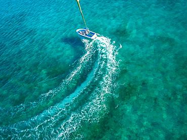 Speedboat turning in ocean, Carribean