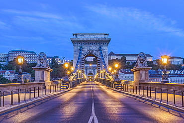 Lion statues and illuminated streetlamps along Chain Bridge, Budapest, Hungary