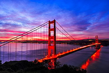 Golden Gate Bridge lit up at sunset, San Francisco, California, United States