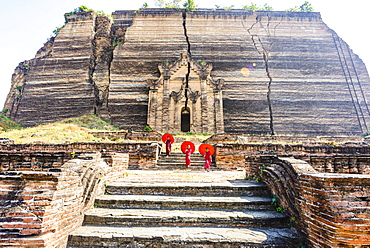 Asian women exploring temple ruins, Mingun, Saigang, Myanmar