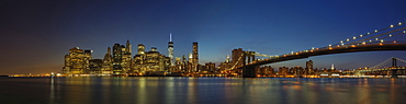 Panoramic view of New York city skyline illuminated at night, New York, United States