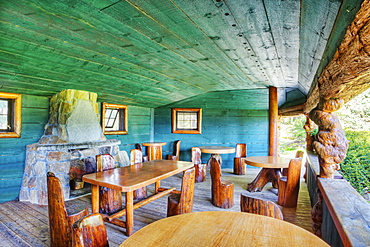 Rustic chairs and tables on restaurant patio