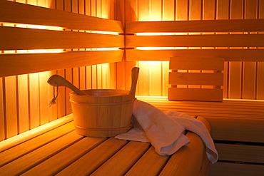 Bucket and towels in sauna