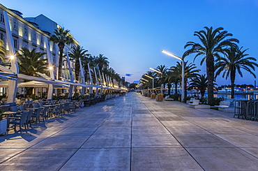 Promenade, buildings and city sidewalk at dusk, Split, Split, Croatia