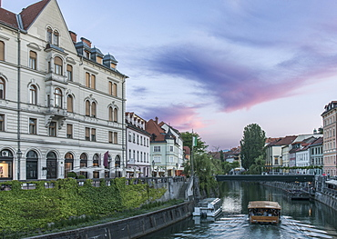 Buildings and pedestrian bridge over urban canal, Ljubljana, Central Slovenia, Slovenia