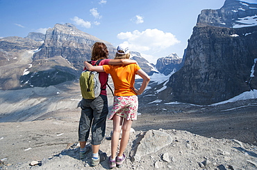 Caucasian mother and daughter admiring scenic view of Six Glaciers Trail, Banff, Alberta, Canada
