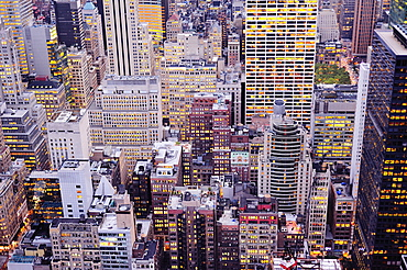 Aerial view of highrise buildings in cityscape at twilight
