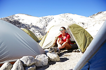 Hiker sitting in tent at campsite, Leavenworth, Washington, USA