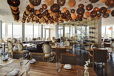 Lanterns over tables in modern restaurant, Miami, Florida, USA