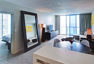 Mirror and lounge area in hotel room, Miami, Florida, USA
