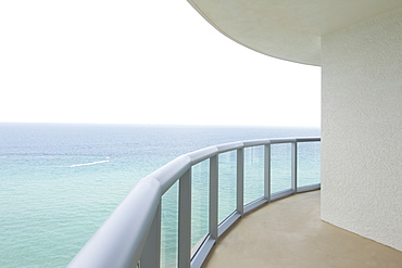 Empty balcony overlooking ocean, Miami, Florida, USA
