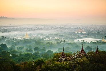 Aerial view of towers in misty landscape, Bagan, Myanmar