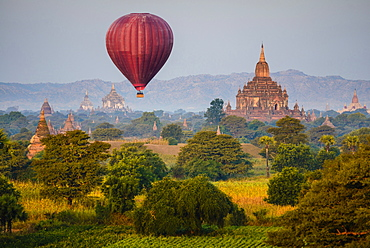 Hot air balloon flying over towers, Bagan, Myanmar