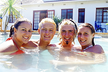 Caucasian friends smiling in swimming pool, Sussex, Eastbourn, England