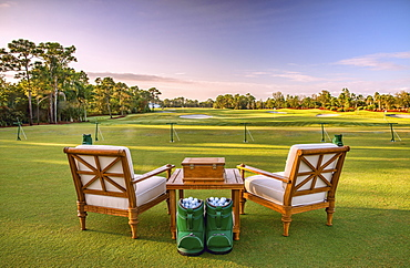Chairs and golf balls on driving range, Stuart, Florida, USA