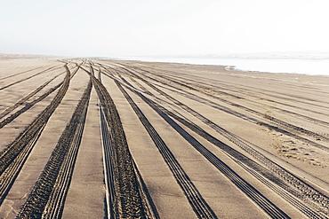 Tire tracks on the soft surface of sand on a beach, Long Beach Peninsula, Washington, United States