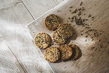 High angle close up of freshly baked seeded crackers, England