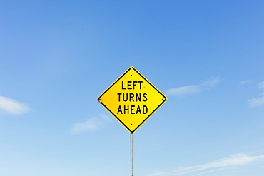 Left Turns Ahead yellow traffic sign, Whitman County, Washington, USA