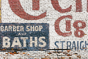 """Barber Shop & Baths"" sign painted on old brick wall, Palouse County, Washington, USA"