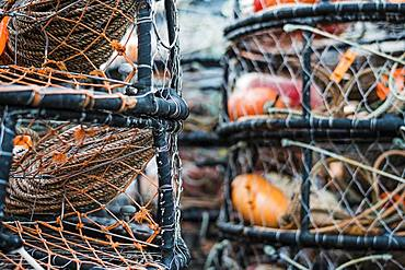 Crab and lobster pots stacked up on the quayside, close up
