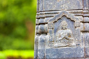 Close up of a carving of Buddha on a statue at an Buddhist Temple, Okayama, Japan