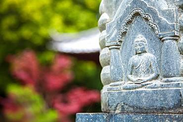 Carving of Buddha on a statue at an Buddhist Temple, Okayama, Japan