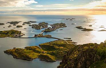Henningsvaer on Lofoten islands with sheltered harbour and bridges connecting rocky islands, Austvagoy, Lofoten Islands, Norway