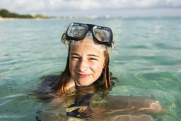 A teenage girl wearing snorkelling mask in the ocean, Grand Cayman, Cayman Islands
