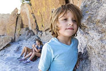 Family visiting the Tsankawi Ruins, a young boy exploring