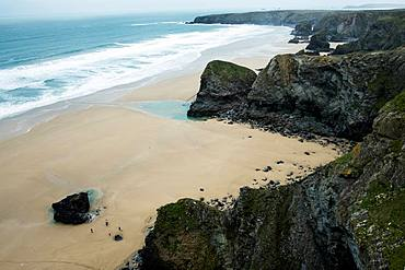 High angle view of a rocky cove on a sandy beach