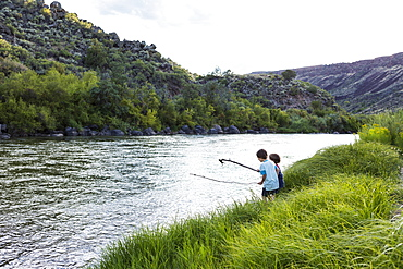 2 boys playing at the edge of the Rio Grande River, Pilar, NM