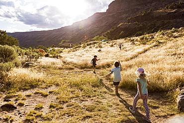children hiking at sunset, Pilar, NM