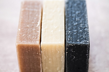 High angle close up of three bars of homemade bars of soap