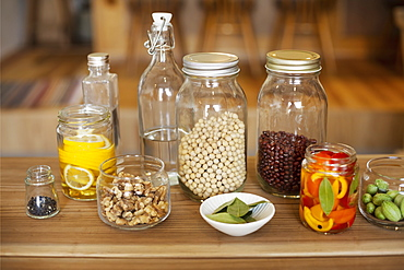 Close up of a selection of condiments and dried pulses in glass jars, Kyushu, Japan