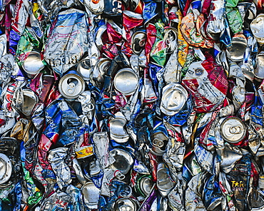 Mass of aluminium cans being processed at a recycling plant, Recycling facility, California, USA