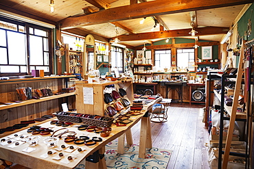 Interior view of a leather shop selling belts, bracelets and handbags, Kyushu, Japan