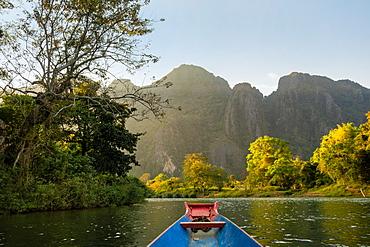 Nam Song River, a boat on the water at Vang Vieng, Laos, Laos