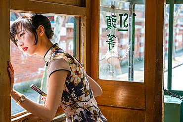 Young Chinese Woman in old tram, Shanghai, China, China